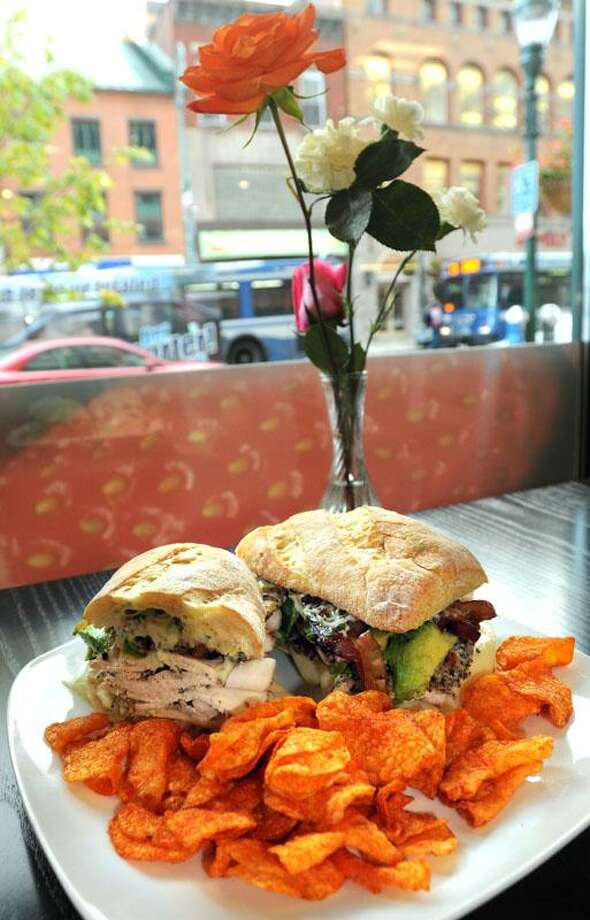 The #9 Grilled chicken and bacon sandwich: grilled chicken breast, bacon, avocado, Jack cheese, basil mayo on a ciabatta. Sweet potato chips. Elm City Market, New Haven. Mara Lavitt/New Haven Register10/10/12