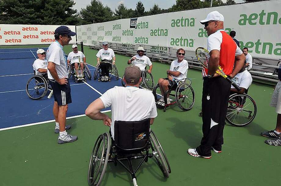 New Haven-- Competitors prepare for wheelchair doubles matches at the Yale Practice courts. The wheelchair athletes from the Gaylord Sports Association put on several exhibition matches for the crowds at the New Haven Open at Yale Tennis Tournament .  Peter Casolino/New Haven Register 8/22/12