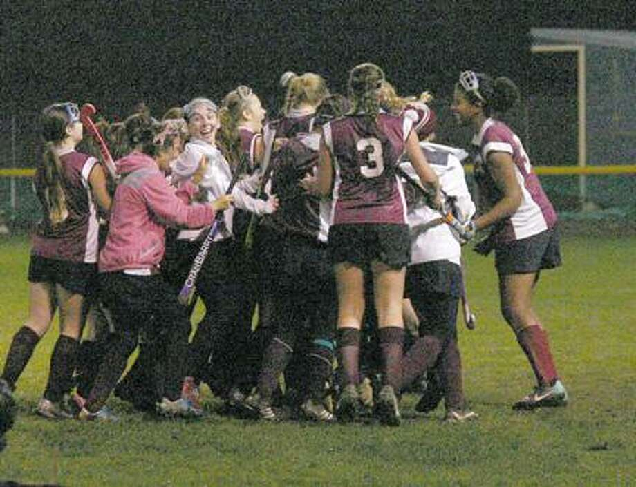 Submitted Photo by JON RATHBUNCanastota's field hockey team celebrates its victory at Little Falls Tuesday, Oct. 23, 2012.