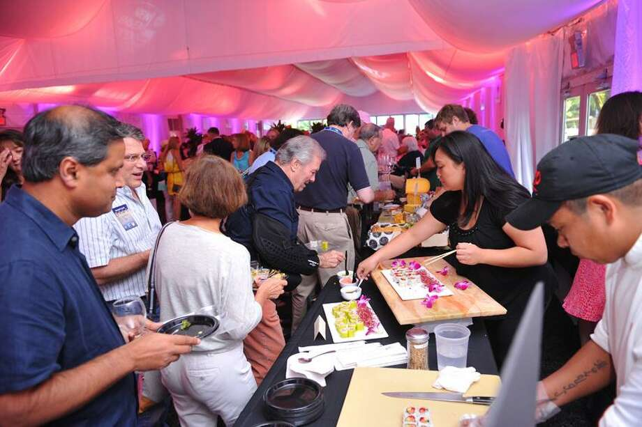 Steve Blazo/Photo  The New Haven Food and Wine Festival was once again a big hit at the New Haven Open Wednesday.