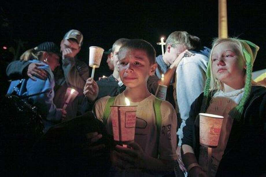 Family members of Autumn Pasquale participate in a candlelight vigil, Monday in Clayton, N.J. together. AP Photo/Joseph Kaczmarek Photo: AP / FR109827 AP