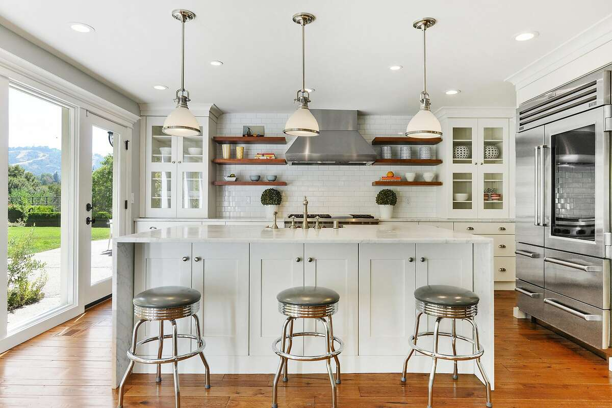 The open chef�s kitchen features professional appliances and a subway tile backsplash.