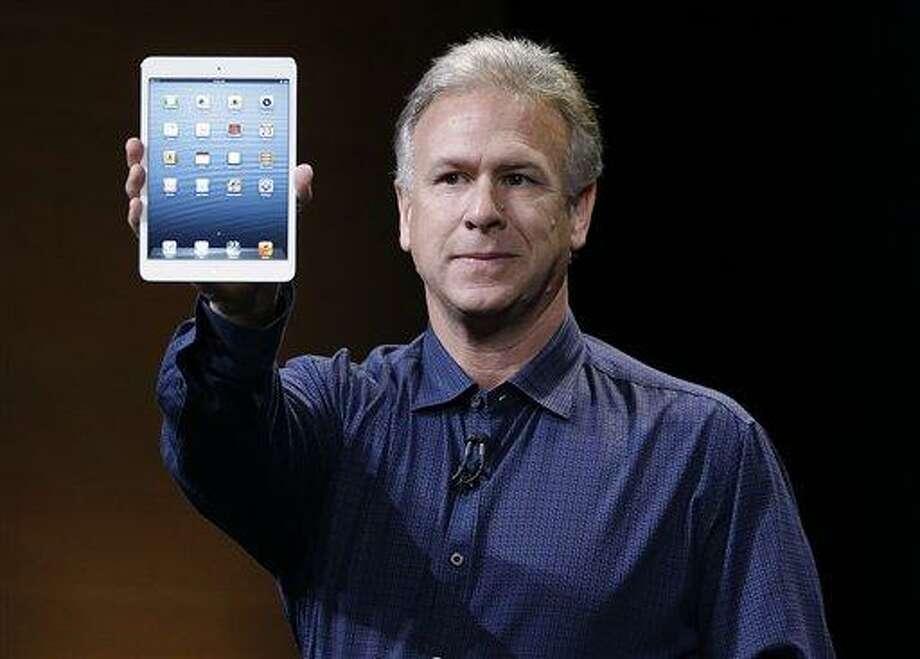 Phil Schiller, Apple's senior vice president of worldwide product marketing, introduces the iPad Mini Tuesday in San Jose, Calif. Associated Press Photo: AP / AP