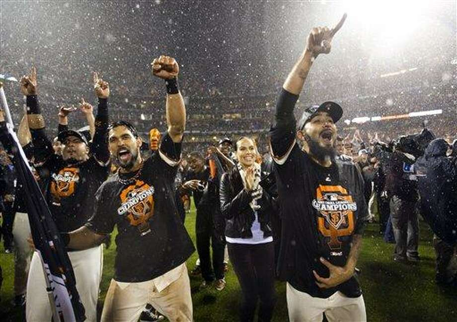 The San Francisco Giants celebrate after the final out in Game 7 of baseball's National League championship series against the St. Louis Cardinals Monday, Oct. 22, 2012, in San Francisco. The Giants won 9-0 to win the series. (AP Photo/David J. Phillip) Photo: AP / The Sacramento Bee