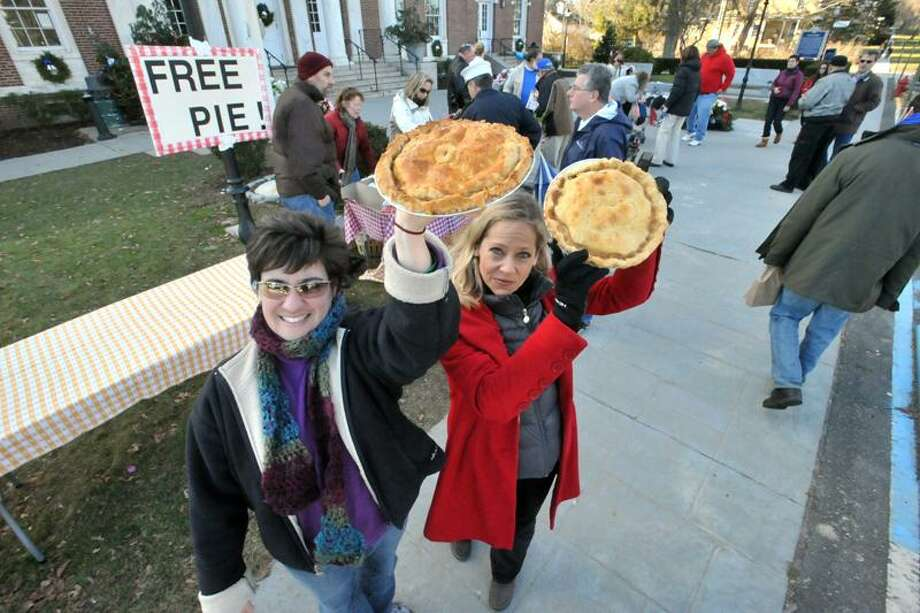 Janice Molinari, left, and Beth Howard of the Pies Across America: Newton Pie Project are slicing pies to serve to passersby at the Edmond Town Hall, Newton, CT. (Markell DeLoatch/DFM)