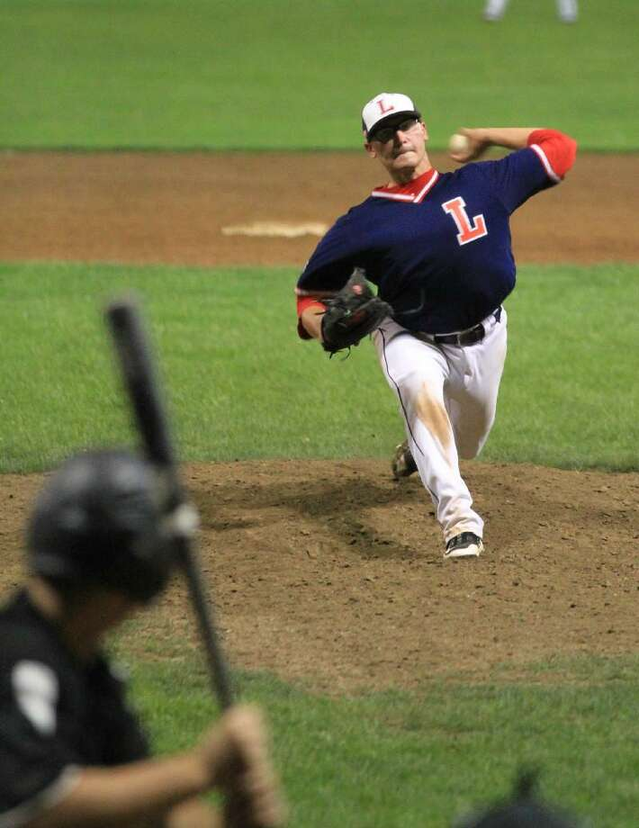 Register Citizen file art Chris Blazek (pitching) and the Litchfield Cowboys will try to win their second straight Tri-State Baseball League title tonight when they play the Waterbury Wild in Game 3 of the World Series at 7 at Fuesenich Park.
