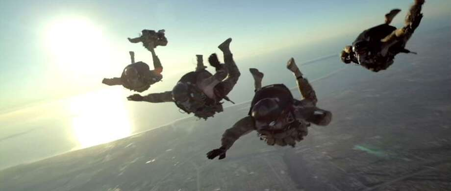 """Relativity photo: Many of the guys up on the screen are real-life Navy SEALs in """"Act of Valor."""" Photo: AP / ©2011 Relativity Media, LLC.  All rights reserved."""