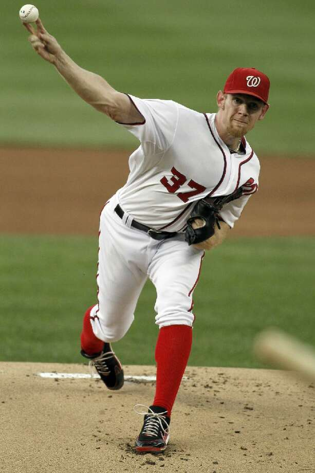 ASSOCIATED PRESS Washington Nationals starting pitcher Stephen Strasburg throws during the first inning of Tuesday night's game against the Atlanta Braves at Nationals Park in Washington. The Nationals won 4-1 behind six good innings from Strasburg, the former Torrington Twister.