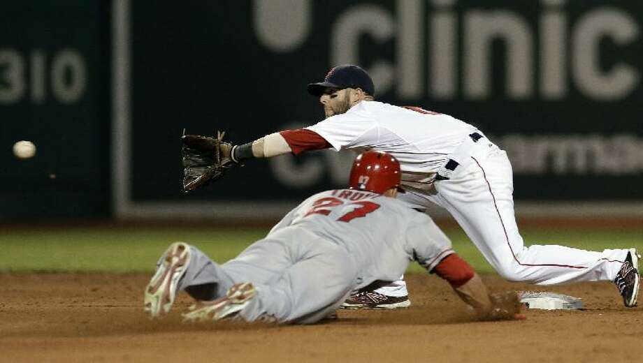 ASSOCIATED PRESS Boston Red Sox second baseman Dustin Pedroia awaits the throw, before tagging out Los Angeles Angels Mike Trout (27) on an attempted steal second during the ninth inning of Tuesday night's game at Fenway Park in Boston. The Angels won 5-3.