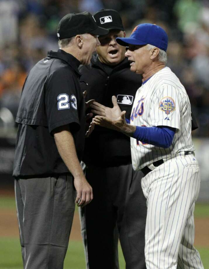 ASSOCIATED PRESS New York Mets manager Terry Collins, right, argues a call by umpires Lance Barksdale, left, and Fieldin Culbreth, center, during the fifth inning of Tuesday night's game against the Colorado Rockies in New York. The Mets lost the game 6-2. Collins was ejected after the discussion.