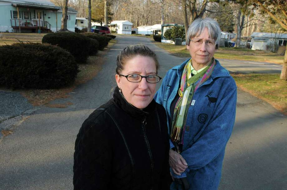 Residents of the Green Acres mobile home park in Westbrook including Brenda Griffin, left, and Paula Chabot, right, are angry about having their lot rental fees go up and getting very little in return from the management. Mara Lavitt/Register