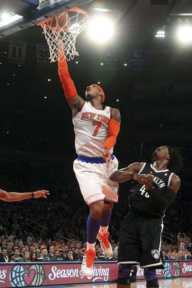 New York Knicks' Carmelo Anthony (7) shoots against Brooklyn Nets' Gerald Wallace during the first half of an NBA basketball game, Wednesday, Dec. 19, 2012, at Madison Square Garden in New York. (AP Photo/Mary Altaffer) Photo: AP / AP2012