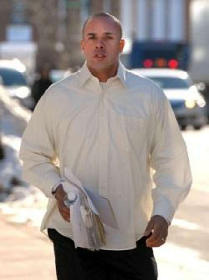 In this file photo, Angelo Reyes of New Haven runs to a hearing at Federal Court in Hartford in 2011. Photo by Mara Lavitt/New Haven
