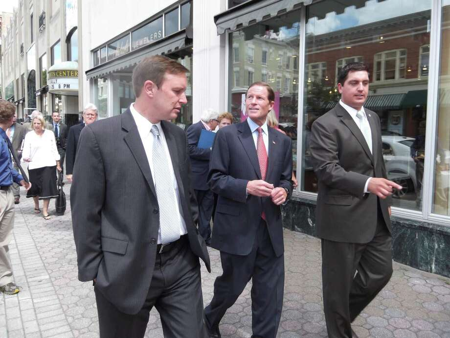 RICKY CAMPBELL/ Register Citizen U.S. Rep. Chris Murphy and U.S. Sen. Richard Blumenthal walk Main Street with Torrington Mayor Ryan Bingham on Wednesday. The two federal legislators were joined by U.S. Rep. John Larson, state legislators and city officials to announce a $500,000 federal grant for Torrington's streetscape project.