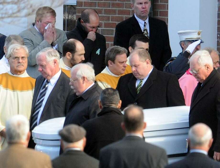 0632: Pallbearers carry the casket of  Caroline Previdi, 6, after her funeral at the St. Rose of Lima Roman Catholic Church in Newtown, Conn.  Wednesday, December 19, 2012. Previdi was killed by a gunman that also claimed the lives of 6 adults and 19 other children at the Sandy Hook Elementary School shooting Friday, December 14, 2012.   Photo by Peter Hvizdak / New Haven Register Photo: New Haven Register / ©Peter Hvizdak /  New Haven Register