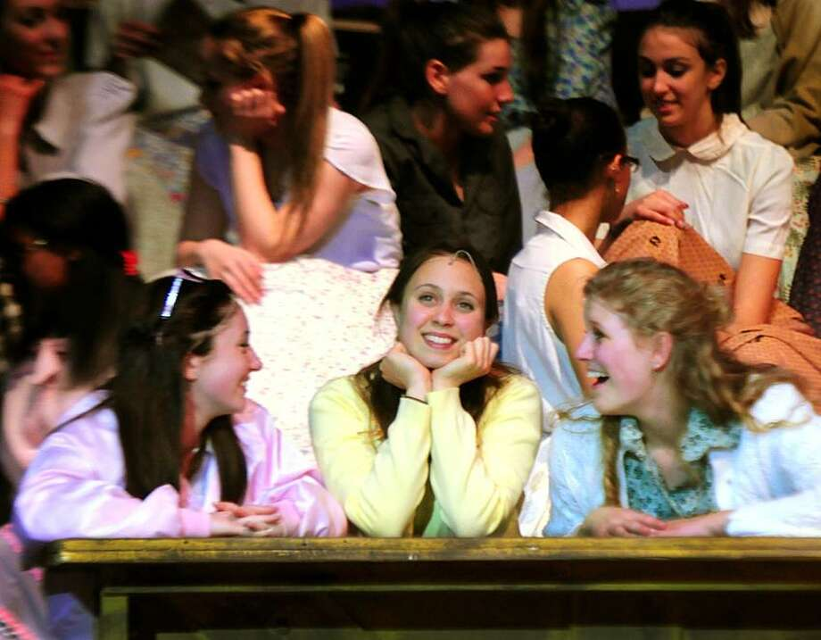 Hillary Dadio-Perrone, center, playing Sandy Dombrowsk, in a scene from the Hamden High School production of Grease.   Melanie Stengel/Register