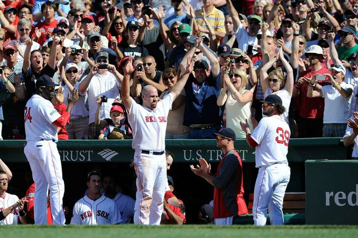 June 24, 2012; Boston, MA, USA; Boston Red Sox third baseman Kevin Youkilis (middle) waves to the crowd during the seventh inning against the Atlanta Braves at Fenway Park. Mandatory Credit: Bob DeChiara-US PRESSWIRE
