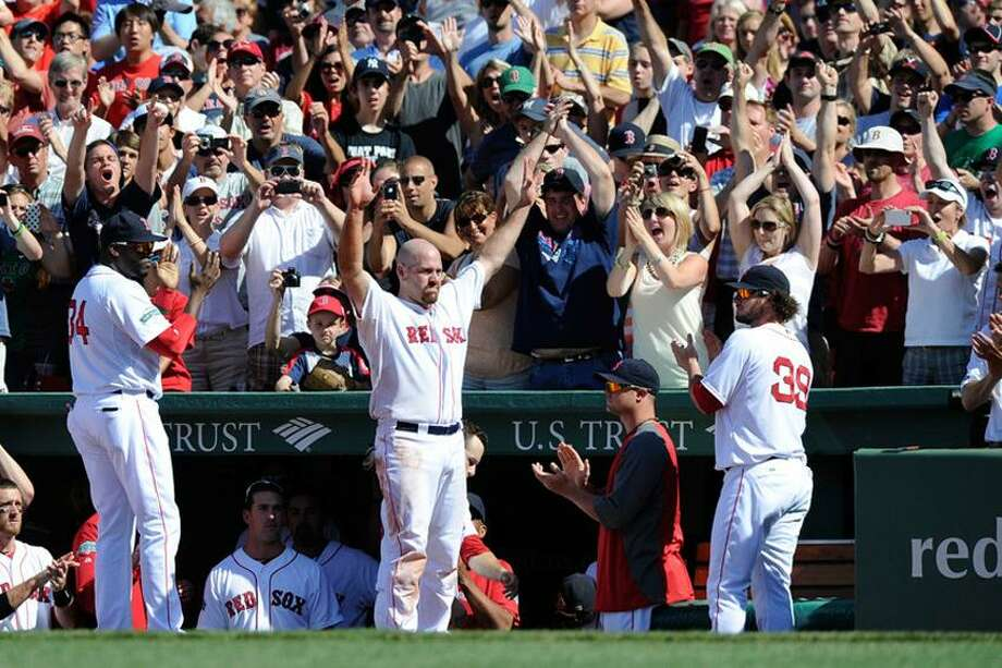 June 24, 2012; Boston, MA, USA; Boston Red Sox third baseman Kevin Youkilis (middle) waves to the crowd during the seventh inning against the Atlanta Braves at Fenway Park. Mandatory Credit: Bob DeChiara-US PRESSWIRE Photo: US PRESSWIRE / Bob DeChiara