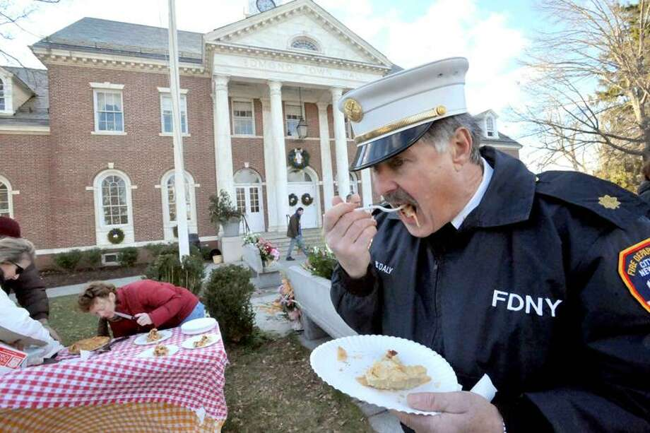 New York City fireman Dan Daley stops by Edmond Town Hall, Newtown, CT, for a taste of pie, while in the area following a funeral for those killed at Sandy Hook. Pies Across America is giving away pies to put a smile on faces in the town following tragedy. (Markell DeLoatch/ DFM)