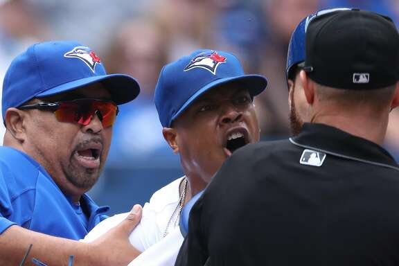 TORONTO, ON - JULY 27: Marcus Stroman #6 of the Toronto Blue Jays argues with home plate umpire Will Little #93 as he is restrained by bench coach DeMarlo Hale #16 after being ejected in the fifth inning during MLB game action against the Oakland Athletics at Rogers Centre on July 27, 2017 in Toronto, Canada. (Photo by Tom Szczerbowski/Getty Images)