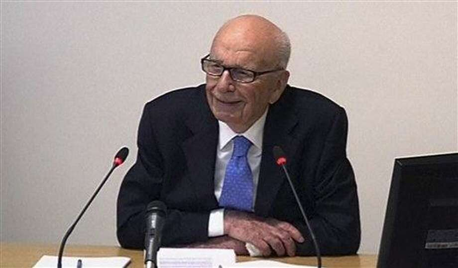 In this image from video, News Corp. chairman Rupert Murdoch appears at Lord Justice Brian Leveson's inquiry in London Wednesday.  Associated Press Photo: AP / POOL
