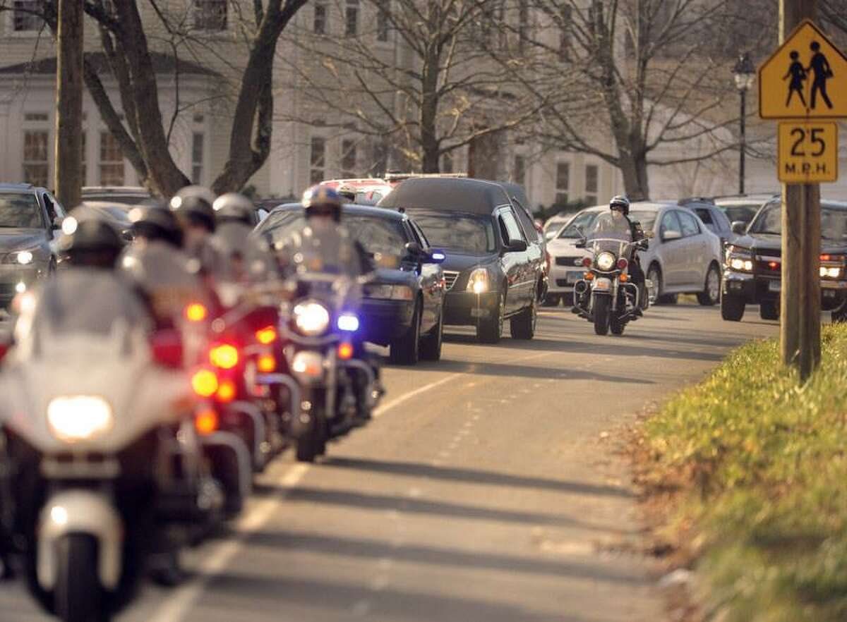 0447: The hearse carrying the casket of Caroline Previdi, 6, ia victim of the Sandy Hook Elementary School shooting, is escorted by police motorcycles down Church Hill Road in Newtown, Conn. to the St. Rose of Lima Roman Catholic Church Wednesday, December 19, 2012. Previdi was killed by a gunman who also claimed the lives of 6 adults and 19 other children at the Sandy Hook Elementary School Friday, December 14, 2012. Photo by Peter Hvizdak / New Haven Register