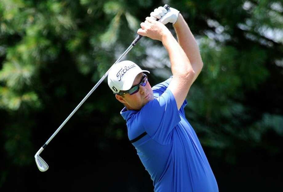 Marc Leishman, of Australia, watches his drive on the 10th hole during the final round of the Travelers Championship golf tournament in Cromwell, Conn., on Sunday, June 24, 2012. (AP Photo/Fred Beckham) Photo: AP / AP2012