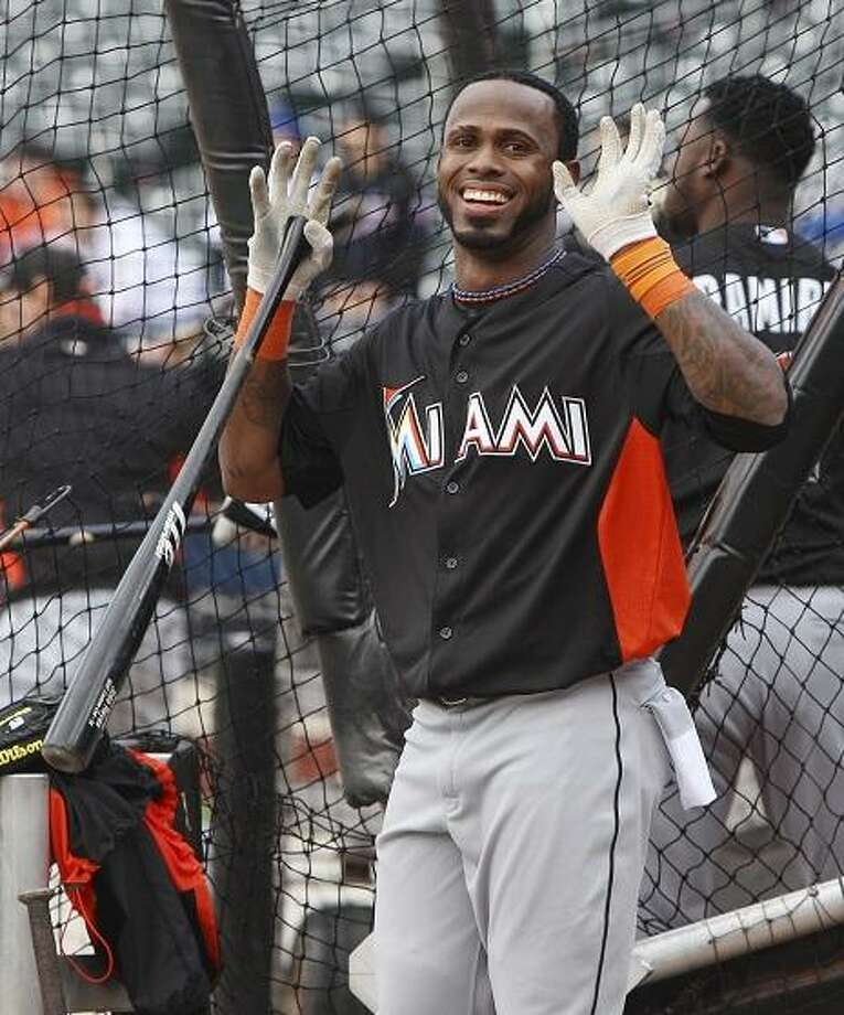 Miami Marlins' Jose Reyes reacts to fans before a baseball game against the New York Mets on Tuesday, April 24, 2012, at Citi Field in New York. (AP Photo/Seth Wenig) Photo: ASSOCIATED PRESS / AP2012
