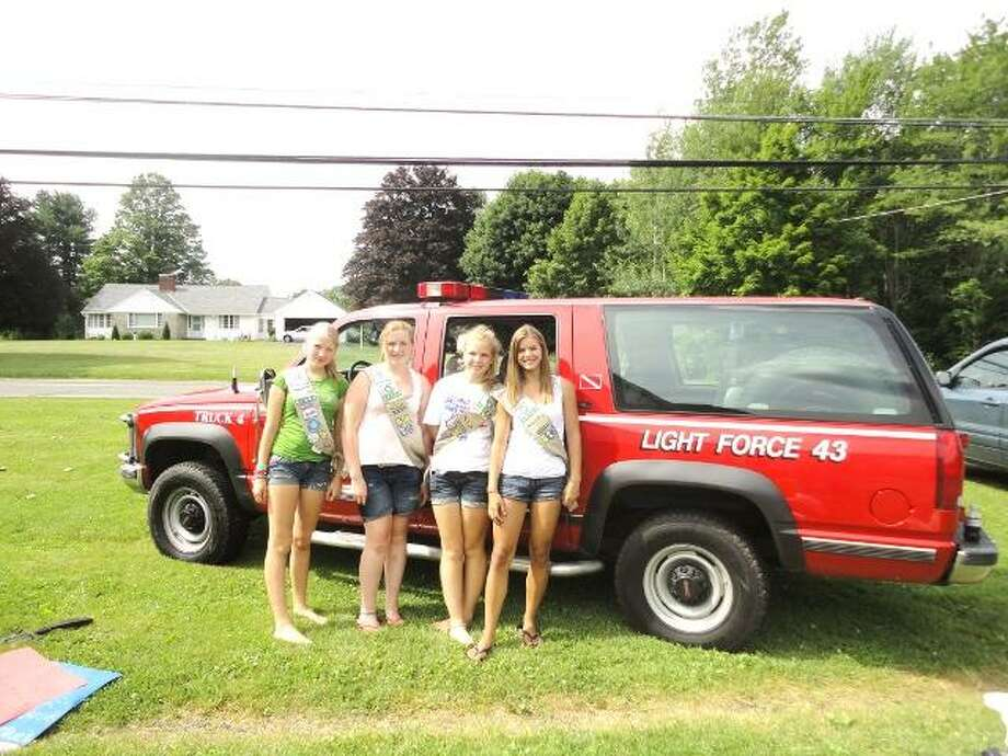JASON SIEDZIK/ Register Citizen Eliza Porter, Danielle Tillmann, Emma Bixler and Rachel Piontkewicz helped fill one of the Goshen Volunteer Fire Department's trucks with food to donate to the Torrington Chapter of FISH.