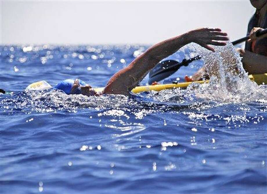 Endurance swimmer Diana Nyad swims in the Florida Straits between Cuba and the Florida Keys Monday. After experiencing problems, Nyad was pulled from the water Tuesday. Associated Press Photo: AP / Diana Nyad via the Florida Keys News Bureau