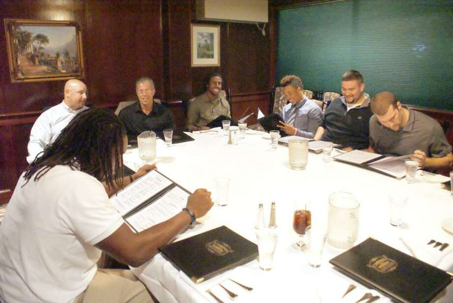 Players and coaches from the New Haven and Southern Connecticut State football teams had their annual dinner at Carmine's Tuscan Grill Monday night. The two rivals will face off Saturday at DellaCamera Stadium.  (Submitted photo)