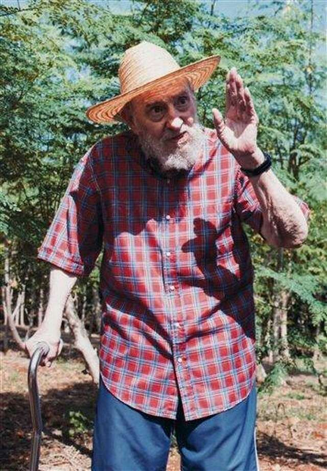 This picture released by Cubadebate on its website early Monday Oct. 22, 2012 shows Cuban leader Fidel Castro in Habana, Cuba Sunday Oct. 21, 2012.  Castro has written Sunday an article in state-media criticizing those who spread rumors he was on his death bed.  Persistent rumors circulated last week that the former Cuban leader was on his deathbed or had suffered a massive stroke.(AP Photo/Alex Castro, Cubadebate) Photo: AP / Cubadebate