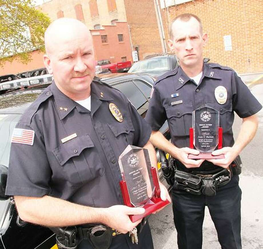 Photo by JOHN HAEGER (Twitter.com/OneidaPhoto) Canastota Chief of Police James Zophy and Officer Sean Barton pose with their recently-award Central New York Association of Chiefs of Police awards for Heroic Action on Wednesday, April 25, 2012 in Canastota.