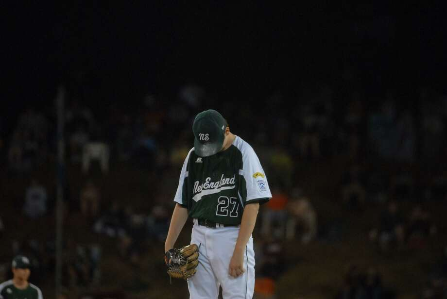 Fairfield American Little League's starting pitcher Matt Kubel hangs his head in the bottom of the second inning at Lamade Stadium on Tuesday night in a an elimination game against Petaluma National of California at the Little League World Series. Fairfield lost 5-0 to end its season. Mary Albl/New Haven Register