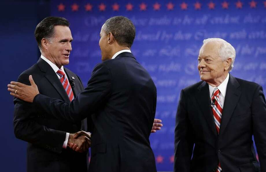 Moderator Bob Schieffer, right, watches as President Barack Obama, center, shakes hands with Republican presidential nominee Mitt Romney during the third presidential debate at Lynn University, Monday, Oct. 22, 2012, in Boca Raton, Fla. (AP Photo/Eric Gay) Photo: AP / AP2010