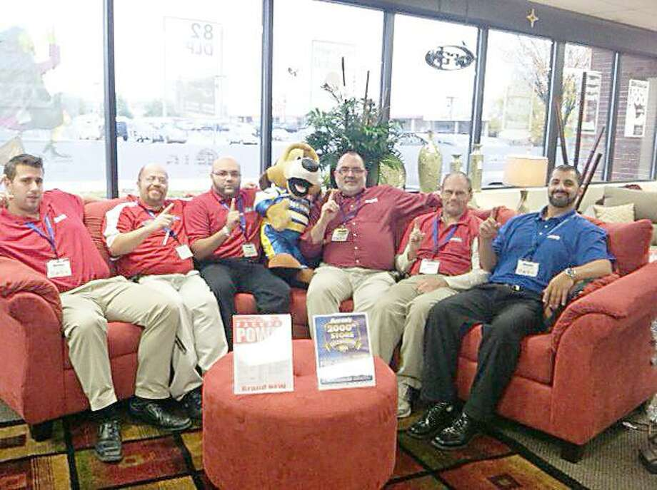 Photo Courtesy ONEIDA CHAMBER OF COMMERCE Employees at Aaron's in Oneida take a moment from their busy schedules to relax on the sofa.