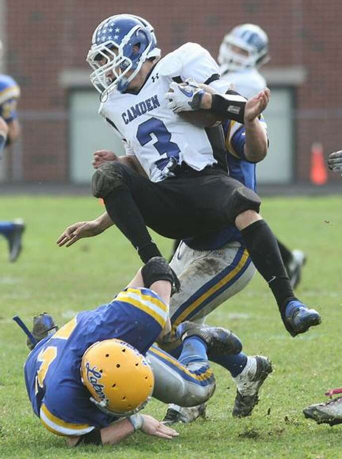 Dispatch Staff Photo by JOHN HAEGER (Twitter: @OneidaPhoto)Cazenovia's Mike Nourse (42) and Patrick Cunningham (58) tackle Camden's Ryan McCarthy (3) during their game in September. The teams will meet for a rematch in Friday's semifinal.