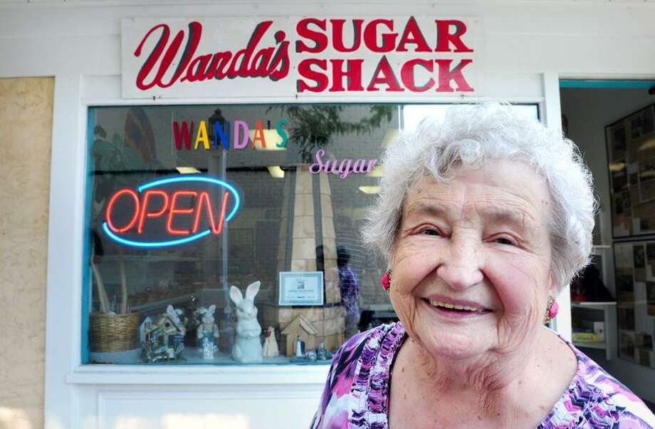 Wanda Hornack is photographed in front of her store, Wanda's Sugar Shack, on Harborwalk in downtown Milford. Photo by Arnold Gold/New Haven Register