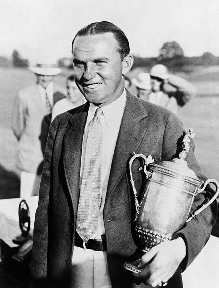 Billy Burke, of Naugatuck, holds the trophy after he won the United States Open Golf Championship at Inverness in Toledo, Ohio. He defeated George Von Elm by one stroke on July 15, 1931. They had two 36-hole playoffs with Burke eventually winning 148 to 149. (AP file photo) Photo: AP / 1931 AP