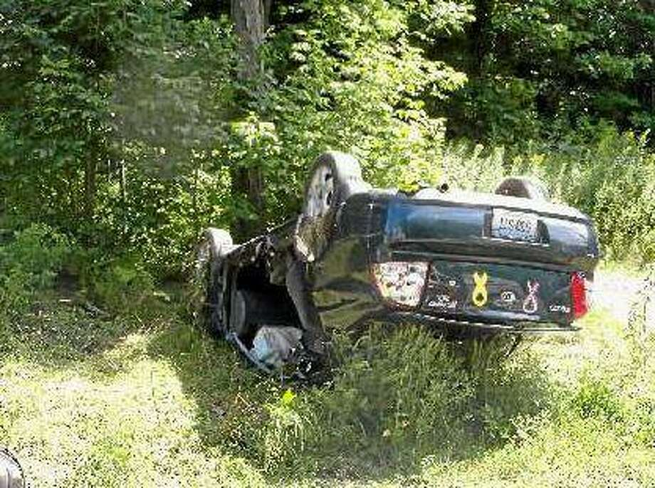 A car flipped over on Route 202 in Litchfield Tuesday afternoon. The driver was the only occupant and was transported to Charlotte Hungerford Hospital. (Michelle Merlin/Register Citizen)