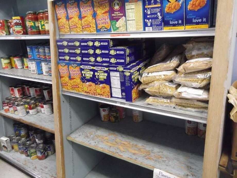 Shelves are bare at the FISH homeless shelter and food pantry in Torrington. Michelle Merlin/Register Citizen