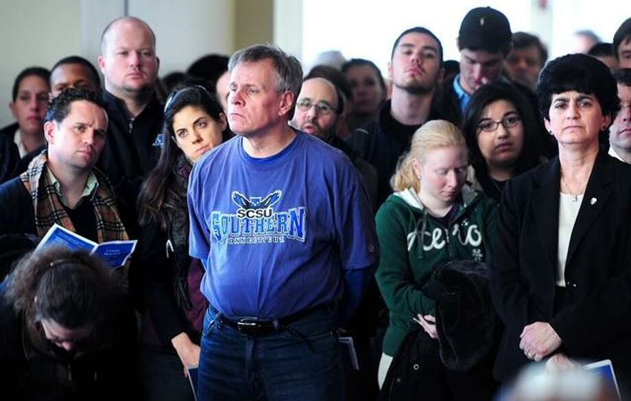 Members of the Southern Connecticut State University community attend a Campus Memorial Gathering at the Adanti Student Center on 12/18/2012.  At far right is SCSU President Mary Papazian. Photo by Arnold Gold/New Haven Register