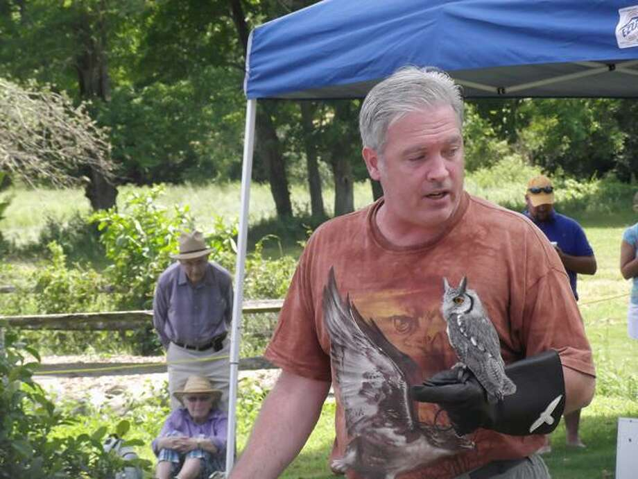 RICKY CAMPBELL/Register Citizen  Falconer Bryan Bradley holds a white-faced owl during the seventh annual Duck Day event in Litchfield on Saturday. The event, sponsored by the Livingston Ripley Waterfowl Conservatory, offered a chance to see about 70 different species of birds.