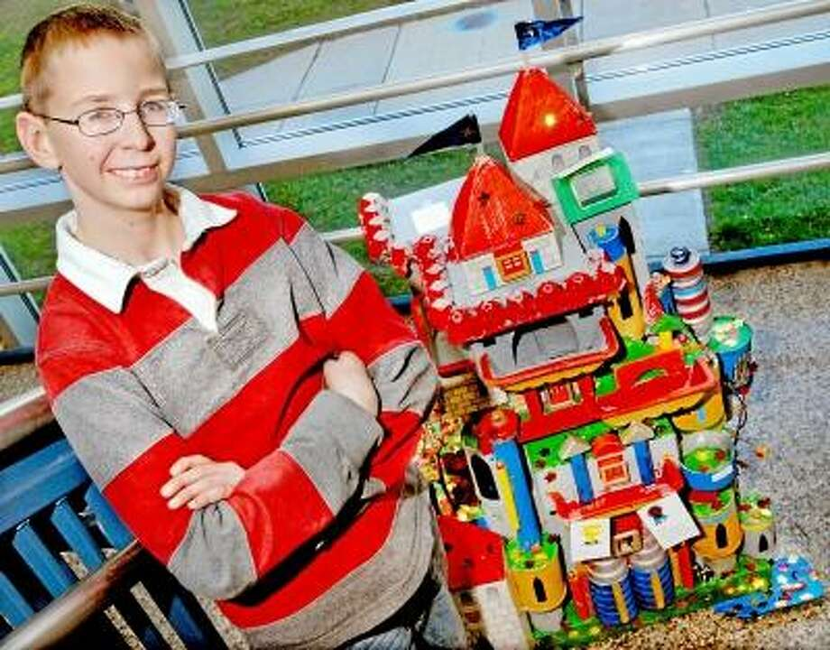 Catherine Avalone/The Middletown Press     Moody Elementary School fourth grader Alex Clark earned best in show with his castle in the City of Middletown Annual Recycled Sculpture Contest in celebration of America Recycles Day. Some of the items Clark used to create his castle included egg cartons, cans, meat trays, paper towel tubes, an ice cream cone as well as the cone styrofoam packaging and a picture of his 11 year old sister wearing a crown because Clark state every castle has to have a princess. All sculptures are on display at city hall until December 20.