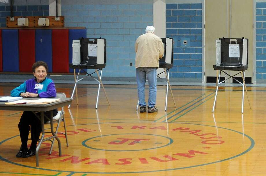 A voter in Branford's First District at the Branford Community House casts a ballot in the Republican  Presidential Primary Tuesday 4/24/12. The New Haven Register witnessed a low voter turnout early Tuesday morning at the First District polling station in Branford and at New Haven's 18th ward polling station at the Nathan Hale School. Photo by Peter Hvizdak / New Haven Register. Photo: New Haven Register / ©Peter Hvizdak /  New Haven Register