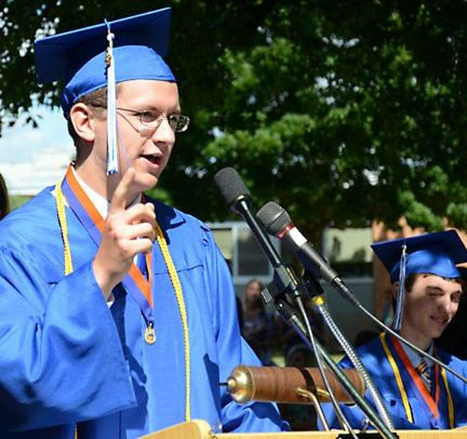 "Salutatorian Tom Mosier talls the crowd ""Read my lips, no new jokes,"" at Oneida High School graduation Saturday. -Dispatch Staff Photo by KURT WANFRIED"