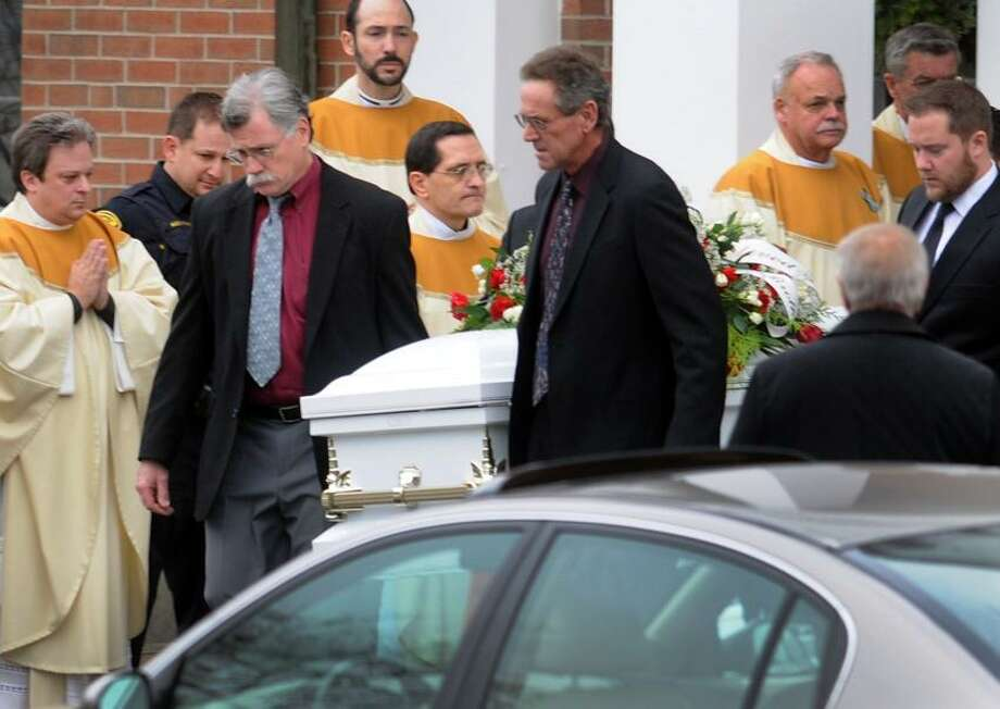 Pallbearers bring the casket of  James Mattioli, 6, of Newtown to the hearse during his funeral at the St. Rose of Lima Roman Catholic church Tuesday morning,  December 18, 2012. Mattioli  was killed by a gunman who  also claimed the lives of 6 adults and 19 other children at the Sandy Hooky Elementary School shooting Friday, December 15, 2012.   Photo by Peter Hvizdak / New Haven Register Photo: New Haven Register / ©Peter Hvizdak /  New Haven Register