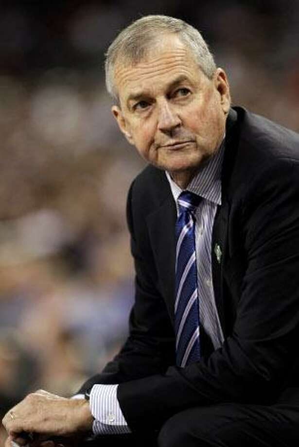 "ASSOCIATED PRESS In this April 4, 2011 file photo, Connecticut head coach Jim Calhoun sits on the sideline during the second half of the men's national championship game against Butler in Houston. Calhoun will undergo surgery next week to address a lower back condition and he will miss the Huskies' next two games, the university said Wednesday. The university said the status of the Hall of Fame coach, who has been on a medical leave of absence since Feb. 3, will then be evaluated on ""a day-to-day basis."""