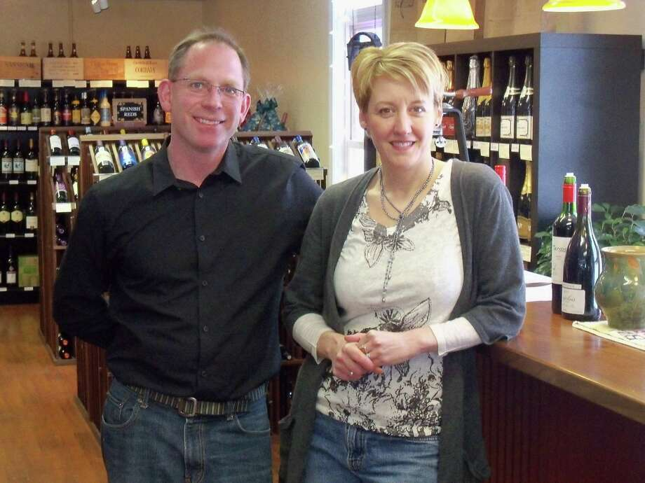Ricky Campbell/Register Citizen  Litchfield Hills Wine Market owners are husband and wife Mike Higgins and Jackie Decker.