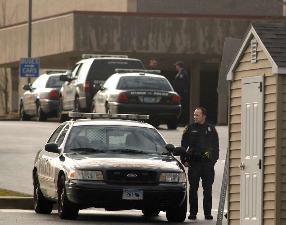 Police at the entrance to Newtown High School during the day on Tuesday. Mara Lavitt/New Haven Register